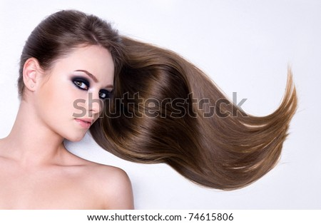 Portrait of beautiful girl with long straight gloss hair - isolated on white - stock photo