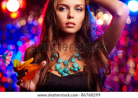 Portrait of beautiful girl with martini glass