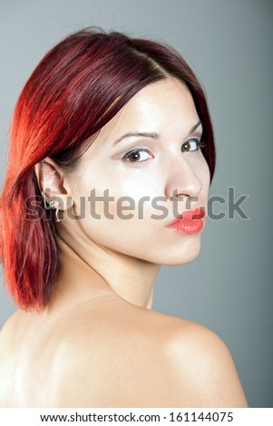 portrait of beautiful girl with red hair
