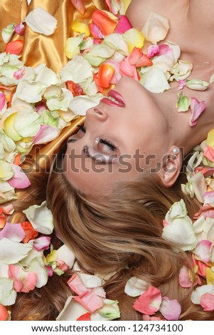 portrait of beautiful girl with rose petals