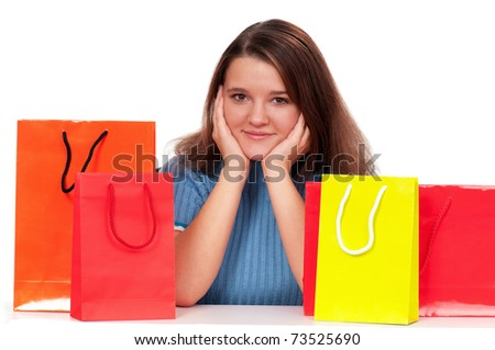 Portrait of beautiful girl with shopping bags