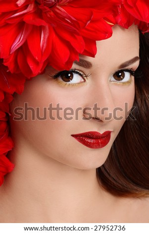 Portrait of beautiful girl with stylish makeup and flowers around her face