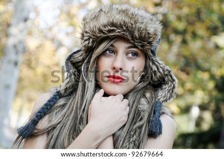 Portrait of beautiful girl with the winter hat on
