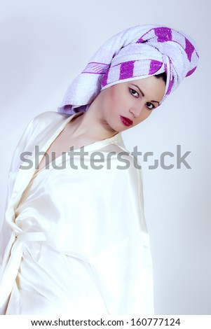 portrait of beautiful girl with towel on her head