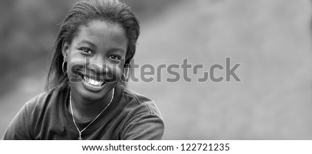 Portrait of Beautiful happy African-American girl  with space for add in black and white
