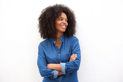 Portrait of beautiful happy black woman standing with arms crossed