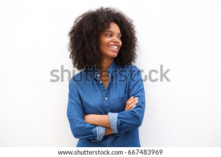 Portrait of beautiful happy black woman standing with arms crossed #667483969