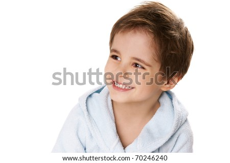 Portrait of beautiful happy smiling little boy in bathrobe on white background