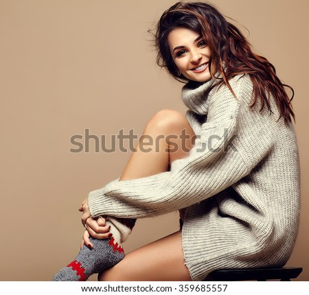 portrait of beautiful happy sweet cute smiling brunette woman girl in casual hipster warm gray sweater clothes, sitting #359685557