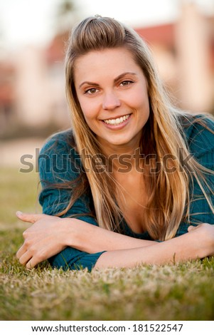 Portrait of beautiful happy young woman outside