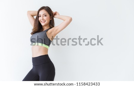 Portrait of beautiful healthy asian woman body curve with sport wear copy space on white background. People beauty perfect body slim fitness girl. Freedom happy and relax lifestyle healthcare concept
