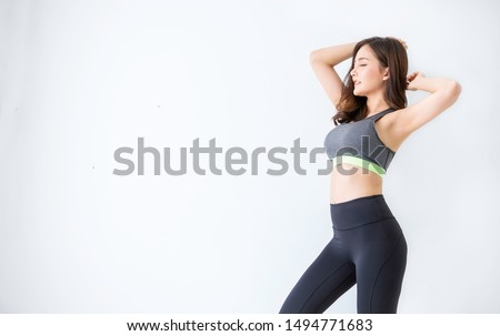 Portrait of beautiful healthy asian woman with sport wear copy space on white background. People beauty perfect body slim fit fitness sexy girl happy and relaxing. Freedom lifestyle healthcare concept