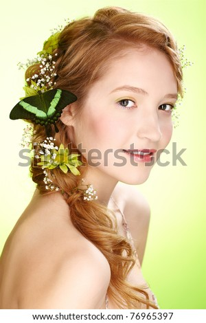 portrait of beautiful healthy redhead teen girl with flowers and butterfly on her hair