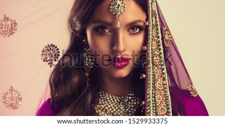 Portrait of beautiful indian girl . Young hindu woman model  in sari and  kundan jewelry . Traditional India costume lehenga choli . Eastern or Arabic culture. Zdjęcia stock ©