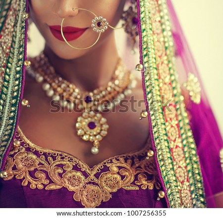 Portrait of beautiful indian girl. Young hindu woman model with kundan jewelry set. Traditional India costume lehenga choli or sari - Shutterstock ID 1007256355