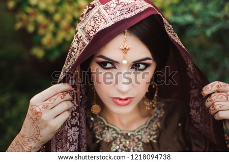2dcafae270 Portrait of beautiful indian girl . Young hindu woman model with tatoo  mehndi and kundan jewelry