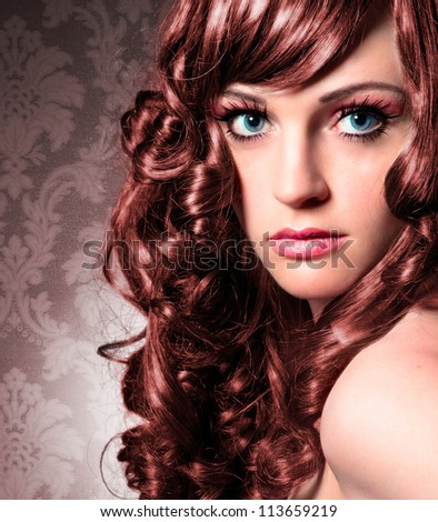 portrait of beautiful lady with red curly hair