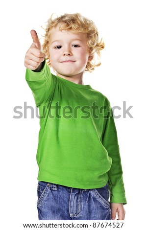 Portrait of beautiful little boy giving you thumb up over white background