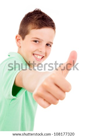of beautiful little boy giving you thumbs up over white background