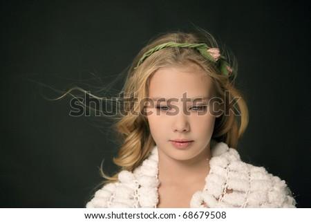 Portrait of beautiful little girl on black background. Studio shot