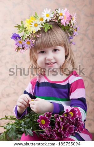 portrait of beautiful little girl with flowers