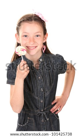 Portrait of beautiful little girl with lollipop isolated on white