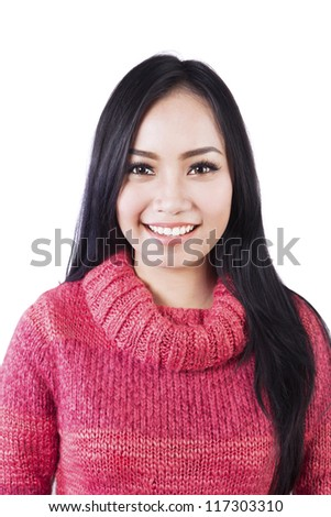 Portrait of beautiful long black hair woman wearing red sweater isolated on white