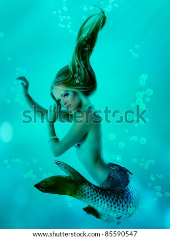 portrait of beautiful mermaid girl with fish tail and long blond hair magic mythology being original photo compilation