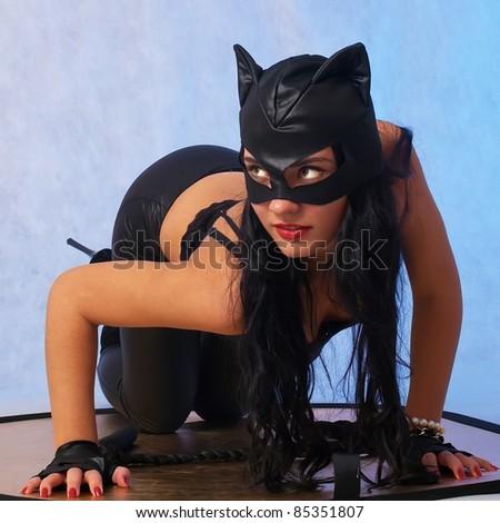 Portrait of beautiful model in cat costume - stock photo