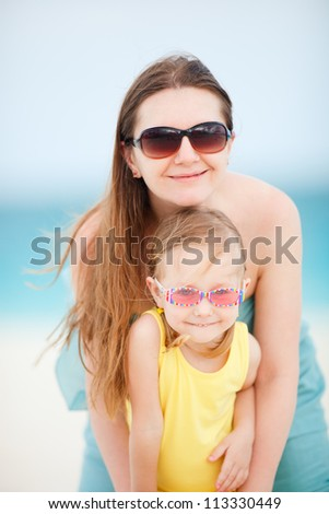 Portrait of beautiful mother and her adorable little daughter