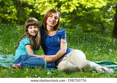Portrait of beautiful mother and her daughter enjoy in nature,Mother and daughter in nature