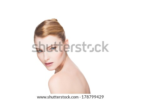portrait of beautiful natural and expressive woman on white background looking over shoulder