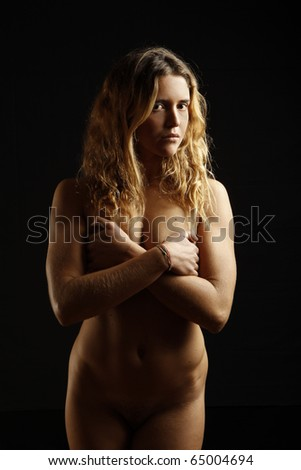 stock photo : portrait of beautiful nude young girl on black background