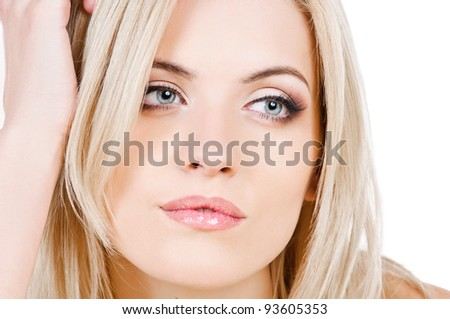 portrait of beautiful peroxide blonde girl on white