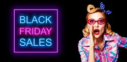 Portrait of beautiful pinup woman in red glasses, holding hand near open mouth and saying something. Blond haired pin up girl at retro vintage studio concept. Black Friday sales neon light sign.