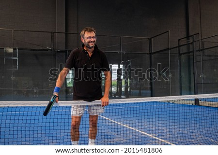 Portrait of beautiful play padle man ready to paly in the padle or tennis court Stock fotó ©
