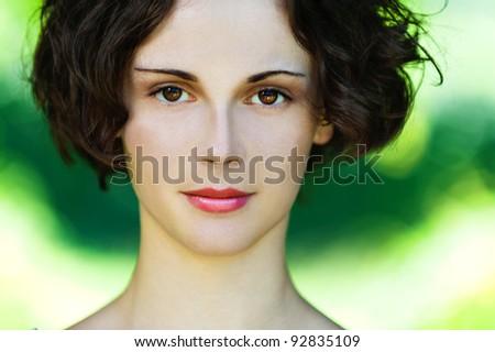 Portrait of beautiful polish girl close up on green background.