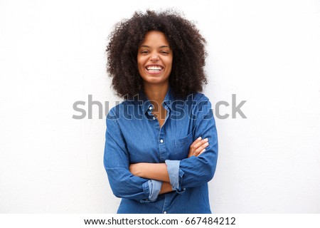 Portrait of beautiful positive african american woman standing with arms crossed #667484212