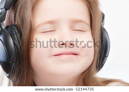 Portrait of beautiful preschool child in headphones.