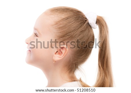 Portrait of beautiful preschool child in profile, isolated on white background.