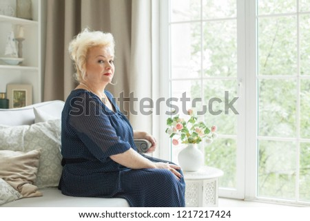 Portrait of beautiful senior woman at home #1217217424