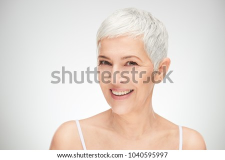 Portrait of beautiful senior woman in front of white background. ストックフォト ©
