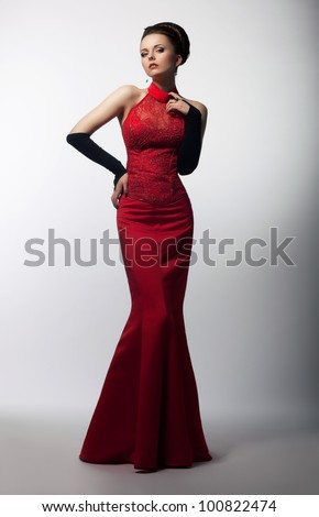 Portrait of Beautiful Sensual Woman in Fashion Red Dress. Christmas Sales and Shopping concept
