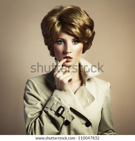 Portrait of beautiful sensual woman with elegant hairstyle. Retro hairdo