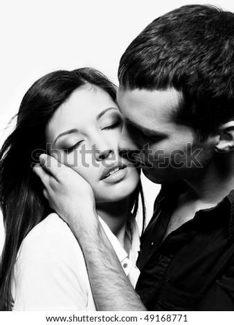 Portrait of beautiful sexual couple posing at studio