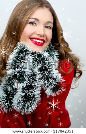 Portrait of beautiful sexy girl wearing santa claus clothes holds Christmas decorations. Christmas