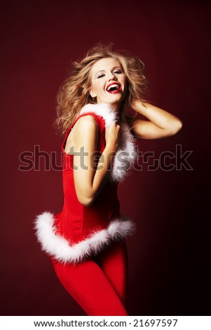 Portrait of beautiful sexy girl wearing santa claus clothes on red background - stock photo