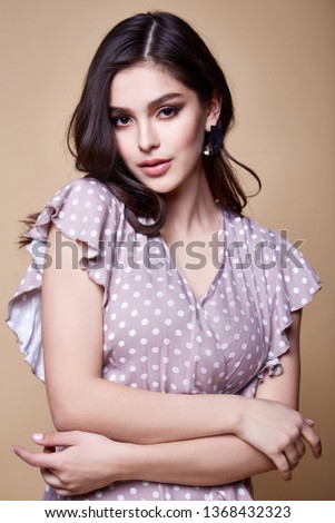 Portrait of beautiful sexy woman perfect face cosmetic skin care beauty salon hairdo hair style model blush mascara lipstick glamor collection accessory jewelry earrings cream young pure lotion nail.