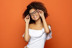 Portrait of beautiful smiling black woman in glasses