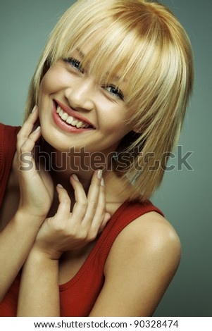 portrait of beautiful smiling girl with perfect skin on a dark background